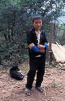 Laos, Udom Xai Province, Na Mor..Hmong boy...Photo by Kees Metselaar, 2003