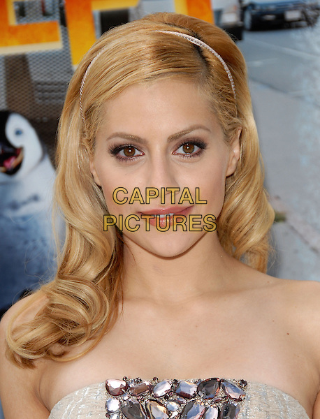 BRITTANY MURPHY.attends AFI Film Festival & Warner Brothers' Screening of Happy Feet held at The Grauman's Chinese Theatre in Hollywood, California, USA,.November 12th, 2006   .portrait headshot hairband hair band strapless beige embellished beaded jewelled smiling  .CAP/RKE/DVS .©DVS/RockinExposures/Capital Pictures