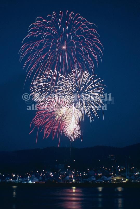 2985-TL Fireworks, Fourth of July, from barge in harbor at Monterey, California