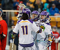 Sean Eccles (#38) celebrates a goal with Justin Reh (#11) and Connor Fields (#5) as UAlbany Men's Lacrosse defeats Richmond 18-9 on May 12 at Casey Stadium in the NCAA tournament first round.