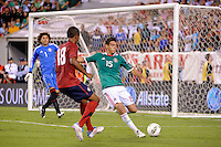 Hector Moreno (15) of Mexico clears the ball away from Juan Agudelo (18) of the United States. The men's national teams of the United States (USA) and Mexico (MEX) played to a 1-1 tie during an international friendly at Lincoln Financial Field in Philadelphia, PA, on August 10, 2011.