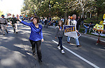 U.S. Senate candidate Sharron Angle walks down Carson Street during the Nevada Day parade in Carson City, Nev., on Saturday, Oct. 30, 2010. Supporter Brittany Sorensen, 11, and Ted Angle are at right..Photo by Cathleen Allison
