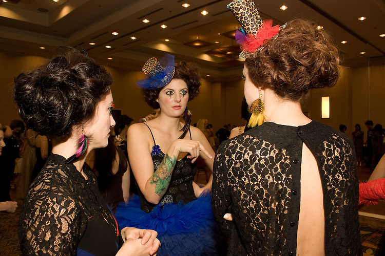 September 17, 2010.  Raleigh, North Carolina..(Left to right) Lauren Youngman, Ashley Reynolds, and Meagan McInerney prepare for the runway in the Sheraton Ballroom.  Outfits were designed by Domino.   .