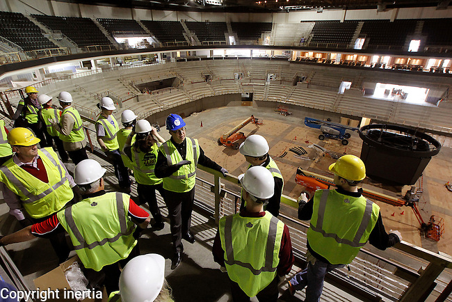 SIOUX FALLS, S.D. -- March 6, 2014 -- Sioux Falls Arena General Manager Terry Torkildson leads a group through the new events center in Sioux Falls.  The Summit League Basketball Championships will move into the new facility for the 2015 tournament.  (Photo by Dick Carlson/Inertia)