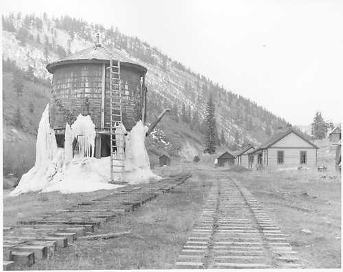Wide-angle south facing view of Brown station with the water tank clad in ice and the rail removed.<br /> RGS  Brown, CO  Taken by Springer, Fred M. - 3/1953