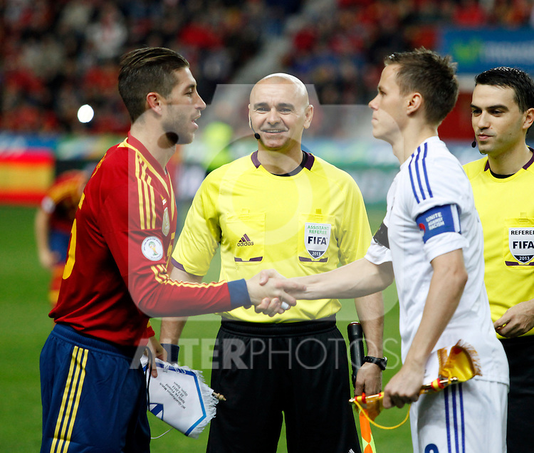 Spain's Sergio Ramos and Finland's Moisander before international match of the qualifiers for the FIFA World Cup Brazil 2014.March 22,2013.(ALTERPHOTOS/Victor Blanco)