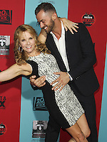 HOLLYWOOD, LOS ANGELES, CA, USA - OCTOBER 05: Lea Thompson, Artem Chigvintsev arrive at the Los Angeles Premiere Screening Of FX's 'American Horror Story: Freak Show' held at the TCL Chinese Theatre on October 5, 2014 in Hollywood, Los Angeles, California, United States. (Photo by Celebrity Monitor)