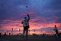 East Rutherford, NJ  ?  Kenny Kodak, 12, of West Islip, NY and a New England Patriots fan has a catch with his brother Michael, 12, a Jets fan under a wild sky outside  MetLife Stadium on Sunday, November 13, 2011.