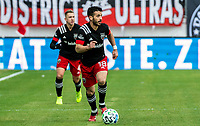 WASHINGTON, DC - FEBRUARY 29: Russell Canouse #4 and Felipe Martins #18 of DC United move up field during a game between Colorado Rapids and D.C. United at Audi Field on February 29, 2020 in Washington, DC.