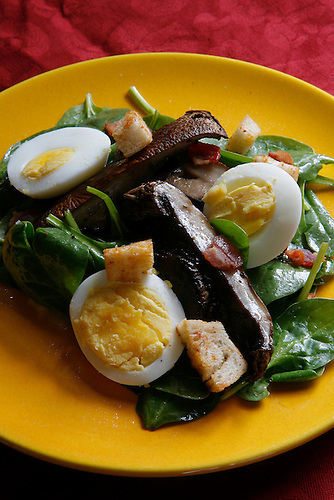 Spinich salad with roasted portobellas and bacon adds mushrooms to a '70's classic recipe.  Texas mushrooms are used in a variety of recipes.     (Thursday, Oct. 4, 2007, in Houston. ( Steve Campbell / Chronicle)