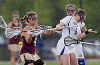 Sarah Bullard (1) of Duke fights for the ball with Brooke Blue (4) of Boston College during the first round of the ACC Women's Lacrosse Championship in College Park, MD.  Duke defeated Boston College, 17-6.
