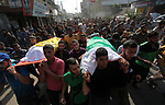Mourners carry the bodies of Palestinians, during thier funeral in Gaza City, on November 13, 2019. Photo by Mahmoud Ajjour