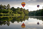 Hot air balloons float above the Ottaquechee River at the Quechee Balloon Fest in Quechee, VT