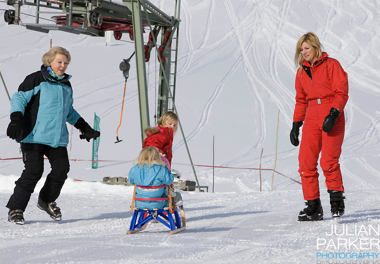 Queen Beatrix of Holland, and Crown Princess Maxima of Holland with Daughters, Princess Alexia, and Princess Ariane attend a Photocall with Members of The Dutch Royal Family during their Winter Ski Holiday in Lech Austria