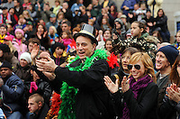 PHILADELPHIA - JANUARY 1:  The crowd applauds the 2011 Mummers Parade in Philadelphia, Pennsylvania. Thousands of people enjoyed the warmer weather and watched the parade, which has been around for over 100 years. (Photo by William Thomas Cain/Getty Images)