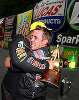 Jun 21, 2015; Bristol, TN, USA; NHRA funny car driver Matt Hagan celebrates with crew member Alex Conaway after winning the Thunder Valley Nationals at Bristol Dragway. Mandatory Credit: Mark J. Rebilas-