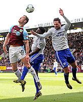Burnley's Ashley Barnes vies for possession with Cardiff City's Bruno Ecuele Manga and Sean Morrison<br /> <br /> Photographer Rich Linley/CameraSport<br /> <br /> The Premier League - Saturday 13th April 2019 - Burnley v Cardiff City - Turf Moor - Burnley<br /> <br /> World Copyright © 2019 CameraSport. All rights reserved. 43 Linden Ave. Countesthorpe. Leicester. England. LE8 5PG - Tel: +44 (0) 116 277 4147 - admin@camerasport.com - www.camerasport.com