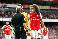 Mattéo Guendouzi of Arsenal makes peace with Thomas Heaton of Aston Villa during the Premier League match between Arsenal and Aston Villa at the Emirates Stadium, London, England on 22 September 2019. Photo by Carlton Myrie / PRiME Media Images.