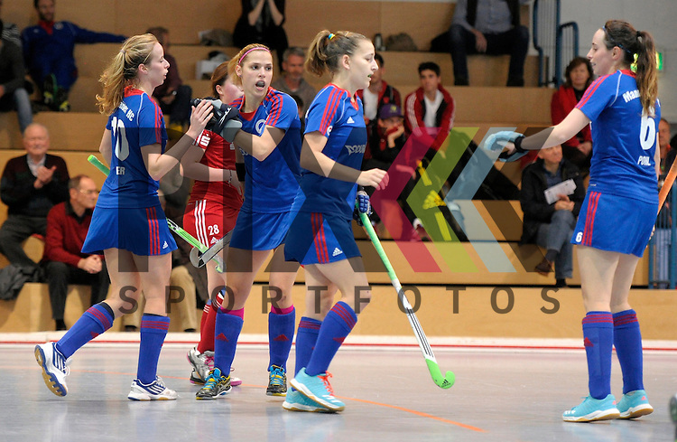 GER - Mannheim, Germany, December 19: During the 1. Bundesliga Sued Damen indoor hockey match between Mannheimer HC (blue) and Nuernberger HTC (red) on December 19, 2015 at Irma-Roechling-Halle in Mannheim, Germany.  (L-R) Greta Lyer #10 of Mannheimer HC, Vera Battenberg #64 of Mannheimer HC, Nadine Kanler #4 of Mannheimer HC<br /> <br /> Foto &copy; PIX-Sportfotos *** Foto ist honorarpflichtig! *** Auf Anfrage in hoeherer Qualitaet/Aufloesung. Belegexemplar erbeten. Veroeffentlichung ausschliesslich fuer journalistisch-publizistische Zwecke. For editorial use only.