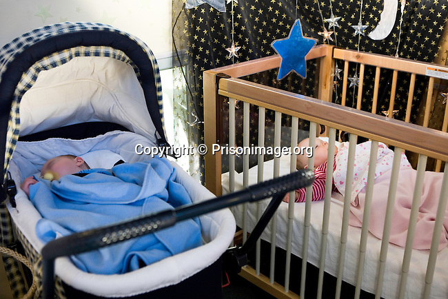 Two babies sleeping one in a pram one in a cot in the mother and baby unit. HMP/YOI Askham Grange is a women's open prison serving the Yorkshire area with a capacity of 128 women. It has extensive education, training and mother and Baby facilities.