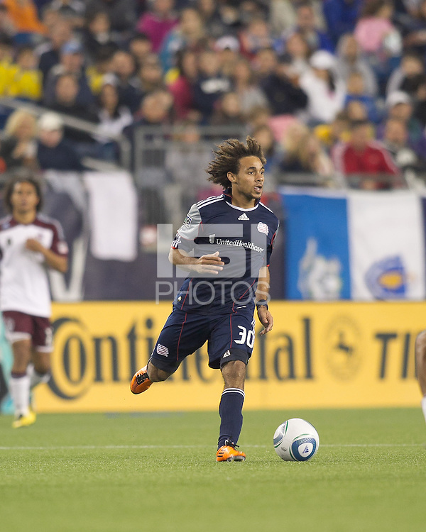 New England Revolution defender Kevin Alston (30) brings the ball forward. In a Major League Soccer (MLS) match, the New England Revolution tied the Colorado Rapids, 0-0, at Gillette Stadium on May 7, 2011.