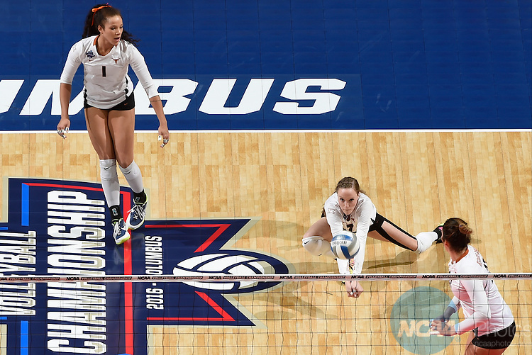 COLUMBUS, OH - DECEMBER 17:  Nicole Dalton (7) of the University of Texas digs the ball against Stanford University during the Division I Women's Volleyball Championship held at Nationwide Arena on December 17, 2016 in Columbus, Ohio.  Stanford defeated Texas 3-1 to win the national title. (Photo by Jamie Schwaberow/NCAA Photos via Getty Images)