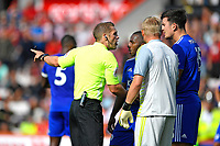 Referee Craig Pawson   has words with Harry Maguire of Leicester City and Kasper Schmeichel of Leicester City after awarding AFC Bournemouth a penalty during AFC Bournemouth vs Leicester City, Premier League Football at the Vitality Stadium on 15th September 2018