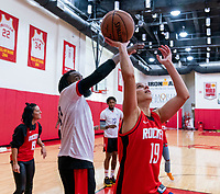 HOUSTON, TX - FEBRUARY 1: James Harden of the Houston Rockets nearly blocks Carli Lloyd #10 of the United States at Houston Rockets Training Center on February 1, 2020 in Houston, Texas.