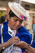 A colombian indigenous woman makes notes about the discussions. The People's Summit at the United Nations Conference on Sustainable Development, Rio de Janeiro, Brazil.
