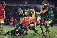 Aled Davies of the Scarlets is tackled by the Leicester Tigers defence. European Rugby Champions Cup match, between Leicester Tigers and the Scarlets on January 16, 2015 at Welford Road in Leicester, England. Photo by: Patrick Khachfe / JMP