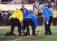 Jan 7, 2010; Pasadena, CA, USA; Security personnel escort a fan off the field during the third quarter of the 2010 BCS national championship game between the Alabama Crimson Tide and Texas Longhorns at the Rose Bowl.  Mandatory Credit: Mark J. Rebilas-