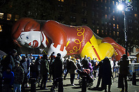 NEW YORK, NY – NOVEMBER 21: Many people crossed the McDonald's balloon while visiting the balloons of the annual Macy's Thanksgiving Day Parade the night before the parade on November 21, 2018 in New York City. (Photo by Pablo Monsalve /VIEWPress)