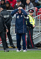 22 October 2011: New England Revolution head coach Steve Nicol gestures to his players during a game between the New England Revolution and Toronto FC at BMO Field in Toronto..The game ended in a 2-2 draw.