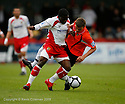 Yemi Odubade of Stevenage Borough and Patrick Cox of Salisbury tangle during the Blue Square Premier match between Stevenage Borough and Salisbury City at the Lamex Stadium, Broadhall Way, Stevenage on 17th October, 2009.© Kevin Coleman 2009 .