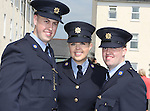 Attending the Garda graduations in Templemore on Thursday were  siblings Jennifer Bell with her graduating brothers Joseph and Brian from Lucan.<br />  Photograph Liam Burke/Press 22
