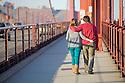 A rear view of a couple walking on the Golden Gate Bridge. San Francisco, California, USA