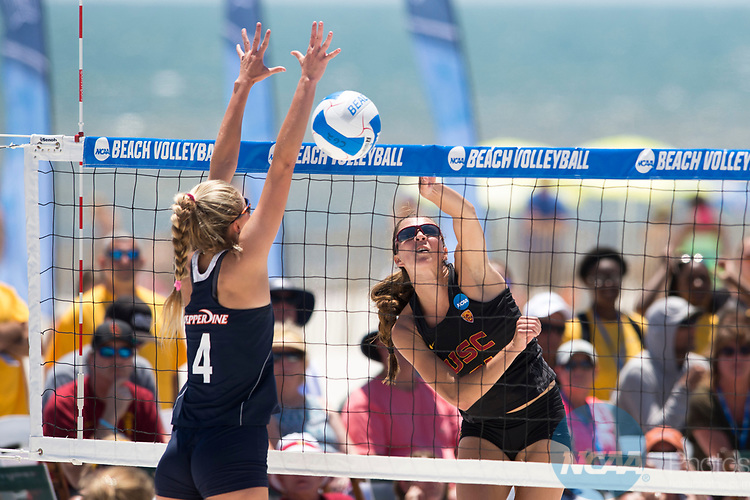 GULF SHORES, AL - MAY 07: Jenna Belton (31) of the University of Southern California hits a shot against Nikki Lyons (4) of Pepperdine University during the Division I Women's Beach Volleyball Championship held at Gulf Place on May 7, 2017 in Gulf Shores, Alabama. (Photo by Stephen Nowland/NCAA Photos via Getty Images)