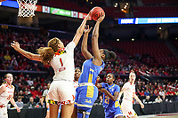 College Park, MD - March 25, 2019: Maryland Terrapins forward Shakira Austin (1) blocks UCLA Bruins forward Lauryn Miller (33) shot during game between UCLA and Maryland at  Xfinity Center in College Park, MD.  (Photo by Elliott Brown/Media Images International)