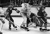 Seals vs. Buffalo Sabres ..Seal #28 Bob Shampoux, with Sabres #6J Schoenfeld, and #7 R  Martin and goalie #1 R   Crozier.(1975 photo/Ron Riesterer)