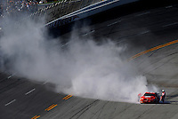 Apr 26, 2009; Talladega, AL, USA; Smoke pours from the car of NASCAR Sprint Cup Series driver Jeremy Mayfield after catching fire during the Aarons 499 at Talladega Superspeedway. Mandatory Credit: Mark J. Rebilas-