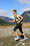 NELSON LAKES, NEW ZEALAND - APRIL 18:  Bridget Robilliard crosses the Travers River during the 2015 Alpine Lodge Loop The Lake trail run at Lake Rotoiti on April 18 16, 2015 in Nelson, New Zealand. (Photo by Marc Palmano/Shuttersport Limited)