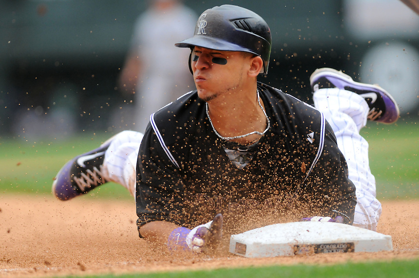 30 JUNE 2011:    Colorado Rockies left fielder Carlos Gonzalez (5) steals thirdbase   during a regular season interleage game between the Chicago White Sox and the Colorado Rockies at Coors Field in Denver, Colorado. The Rockies beat the White Sox 3-2 in 13 innings.   *****For Editorial Use Only*****