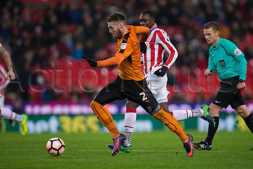 07.01.2017. bet365 Stadium, Stoke, England. FA Cup third round football. Stoke versus Wolverhampton Wanderers. Wolves Matt Doherty chases down a loose ball as Stoke's Giannelli Imbula runs in.