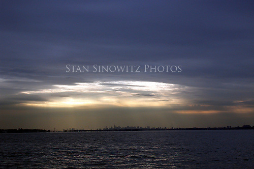 New York City skyline at dusk from Long Island Sound.