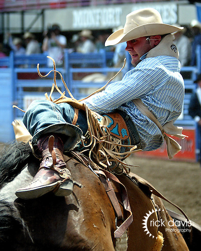 Luke West scores a 66 point bareback ride on Beutler and Son Rodeo Company bronc Crop Top during the short go round of the 2006 Greeley Independence Stampede Rodeo on July 4, 2006.<br />