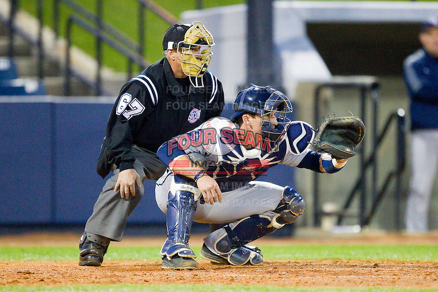 Georgia Southern Eagles catcher Chase Griffin (23) sets his target as home plate umpire Tom Haight looks on during the game against the UNCG Spartans at UNCG Baseball Stadium on March 29, 2013 in Greensboro, North Carolina.  The Spartans defeated the Eagles 5-4.  (Brian Westerholt/Four Seam Images)