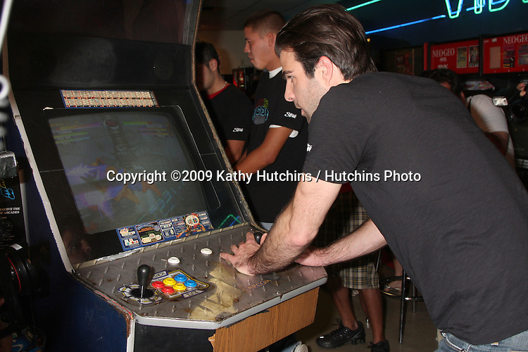 "Zachary Quinto  appearing at Video West Arcade in Glendale, CA  on August 19,  2009 The event kicks off the ""Save the Arcades"" campaign in which STRIDE will feature profiles of four iconic arcades from around the country on the ""Save the Arcades"" website, www.savethearcades.com. Consumers can visit the site and play an arcade-style video game, with their points scored benefitting the featured arcade of their choice. At the end of the campaign, the arcade that has earned the most points, as determined by participating consumers, will be declared the winner and receive $25,000 courtesy of STRIDE gum..©2009 Kathy Hutchins / Hutchins Photo."