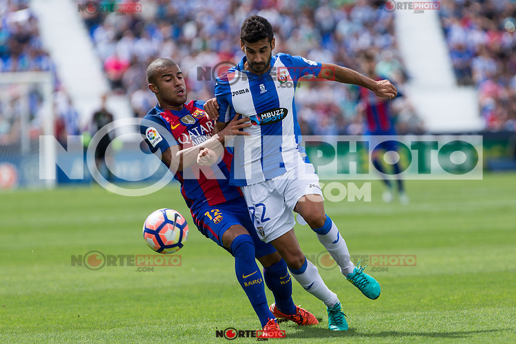 FC Barcelona's Rafinha Alcantara and Club Deportivo Leganes's Lluis Sastre  during the match of La Liga between Club Deportivo Leganes and Futbol Club Barcelona at Butarque Estadium in Leganes. September 17, 2016. (ALTERPHOTOS/Rodrigo Jimenez) /NORTEPHOTO