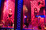 Scantily clad women dance in glass cases behind the bar at Basque Nightclub, Hollywood, CA