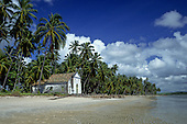 Recife, Pernambuco State, Brazil. A small church on a palm-fringed beach.